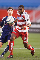 FC Dallas' Roberto Mina is marked by Jay Heaps of the Revolution. The New England Revolution defeated FC Dallas 3 to 2 at Gillette Stadium, Foxbourgh, MA, on July 16, 2005.