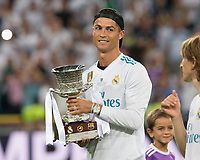 Real Madrid´s Portuguese forward Cristiano Ronaldo with the thophy Super Cup of Spain