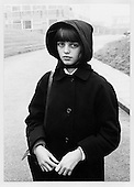 Schoolgirl on a misty morning, Lancashire, about 1970.