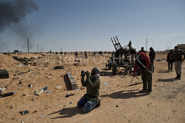 © Remi OCHLIK/IP3 -   RAS LANOUF March 11, 2011 - Opposition forces fight troops of colonel Muamar Gadhafi on a road just outside the strategic oil town of Ras Lanouf, Libya..Loyalist forces bombed the rebels from the air and the ground. At least five oppositin fighters were killed and fifteen injured
