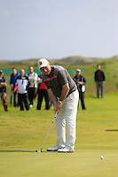 John Garvey (Seapoint) on the 8th green during Round 1 of the Irish Amateur Close Championship at Seapoint Golf Club on Saturday 7th June 2014.<br /> Picture:  Thos Caffrey / www.golffile.ie