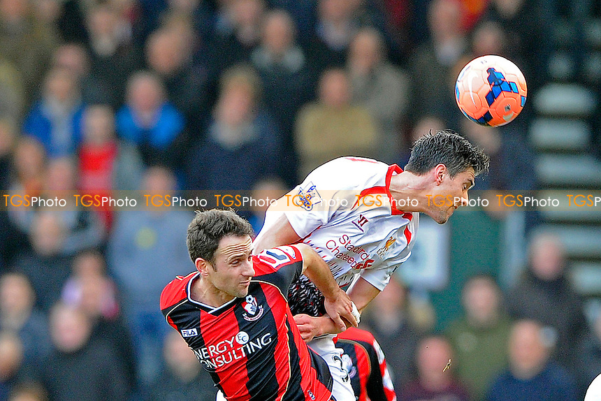 Martin Kelly of Liverpool wins a header from Marc Pugh of AFC Bournemouth - AFC Bournemouth vs Liverpool - FA Cup 4th Round Football at the Goldsands Stadium, Bournemouth, Dorset - 25/01/14 - MANDATORY CREDIT: Denis Murphy/TGSPHOTO - Self billing applies where appropriate - 0845 094 6026 - contact@tgsphoto.co.uk - NO UNPAID USE