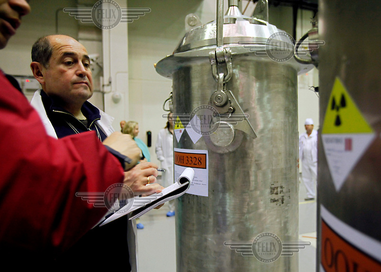 American-Ukrainian physicist Igor Bolshinsky inspects the transfer of highly enriched uranium (HEU) into casks at the Institute of Nuclear Physics in Almaty. The removal of Kazakhstan's HEU is part of the U.S. Global Threat Reduction Initiative (GTRI), where Bolshinsky works, which tries to secure nuclear material around the world to prevent their misuse.
