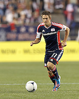 New England Revolution substitute midfielder Kelyn Rowe (11) brings the ball forward. In a Major League Soccer (MLS) match, Montreal Impact defeated the New England Revolution, 1-0, at Gillette Stadium on August 12, 2012.