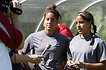 Morgan (left) and Micaela (right) Castain, Washington State freshmen twins, are interviewed following practice on the Lower Soccer Field in Pullman, Washington, on August 12, 2010.