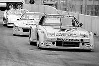 #66 Mazda RX-7 of  Jack Dunham races on the track during the Budweiser Grand Prix of Miami, Bicentennial Park, Miami, FL, February 27, 1983(Photo by Brian Cleary/bcpix.com)