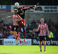 Lincoln City's Michael O'Connor vies for possession with Swindon Town's Elijah Adebayo<br /> <br /> Photographer Andrew Vaughan/CameraSport<br /> <br /> The EFL Sky Bet League Two - Lincoln City v Swindon Town - Saturday August 11th 2018 - Sincil Bank - Lincoln<br /> <br /> World Copyright &copy; 2018 CameraSport. All rights reserved. 43 Linden Ave. Countesthorpe. Leicester. England. LE8 5PG - Tel: +44 (0) 116 277 4147 - admin@camerasport.com - www.camerasport.com