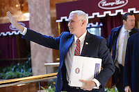 United States Vice President-elect Mike Pence waves to bystanders as he walks through lobby of the Trump Tower in New York, New York, on November 22, 2016.<br /> Credit: Anthony Behar / Pool via CNP /MediaPunch