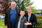 Dalton Reynolds pictured after his confirmation at Holy Family Church, Ballsgrove on Saturday with his parents Amanda and Ralph. Photo: Andy Spearman. www.newsfile.ie