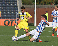 Ross Barbour tackles Adam Drury in the Kilmarnock v St Mirren Scottish Professional Football League Premiership match played at Rugby Park, Kilmarnock on 13.9.14.