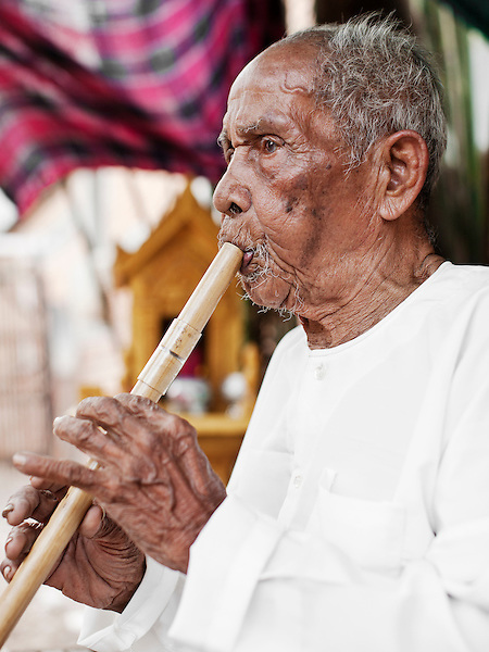 "Master Musician Yim Saing plays the Kloy at his home in Phnom Penh....Yim Saing was born in 1922. At the age of 16 years old, his grandfather and father taught him how to play five woodwind instruments, including the khloy and sralai.  Today, Yim Saing is known as the ""King of the Wind Instruments"" and a master of flutes; he has taught these instruments to most of Cambodia's traditional musicians...The Kloy, (Cambodian flute) is said to have originated from around the seventh century. Records of its existence have been found in carvings on ancient stone pillars, dating from around the year 611 AD...Cambodian Living Arts works to support the revival of traditional Khmer performing arts and to inspire contemporary artistic expression. CLA supports arts education, mentorship, networking opportunities, education, career development, and income generating projects for master performing artists who survived the Khmer Rouge as well as the next generation of student artists."