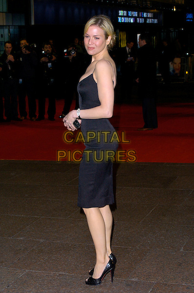 "RENEE ZELLWEGER.""Miss Potter"" World Film Premiere.Empire cinema, Leicester Square.London, England  3rd December 2006.full length black dress open toe Christian Louboutin shoes rear side.CAP/CAN .©Can Nguyen/Capital Pictures"