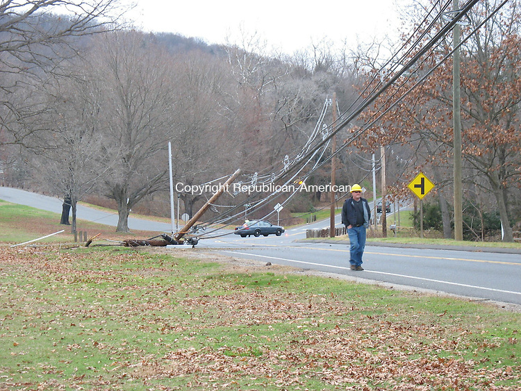 SOUTHBURY, CT - 25 November 2009 - 112509RH01 - A car struck a telephone pole on Route 172 near the Southbury Training School Wednesday, forcing police to close the road between Spruce Brook Road and Flagg Swamp Road