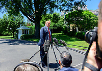 United States President Donald J. Trump takes questions from reporters as he prepares to depart the South Lawn of the White House in Washington, DC for a trip to Iowa.  He will return this evening. Photo Credit: Ron Sachs/CNP/AdMedia