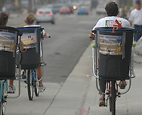 Brie Cichy, Vicky Bowman and Steve Kaelin ride bicycles equipped with trash can at Garnet and Mission Blvd in Pacific Beach on the morning of July 5th, 2008.  The trio were part of a group of volunteers who set out to collect trash from the beach after the big fourth of July holiday.  Volunteers and organisers of several beach clean-ups in the area were stunned by the lack of trash they found compared to what they are used to finding each year on July 5th after the big holiday on the fourth.  The cleanliness of the beaches left many searching the side streets and alleys for trash to collect.  Most people are attributing the drastic change to the six-month old alcohol ban on the area beaches.