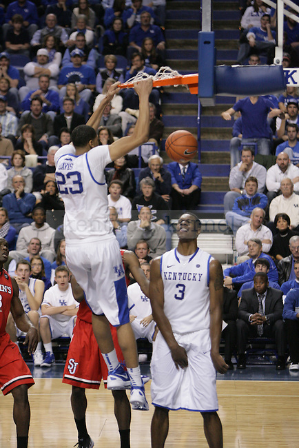 Freshman forward Anthony Davis dunts the ball during the second half of UK's home game against St. John's at Rupp Arena in Lexington, Ky., Dec. 1, 2011. Photo by Brandon Goodwin