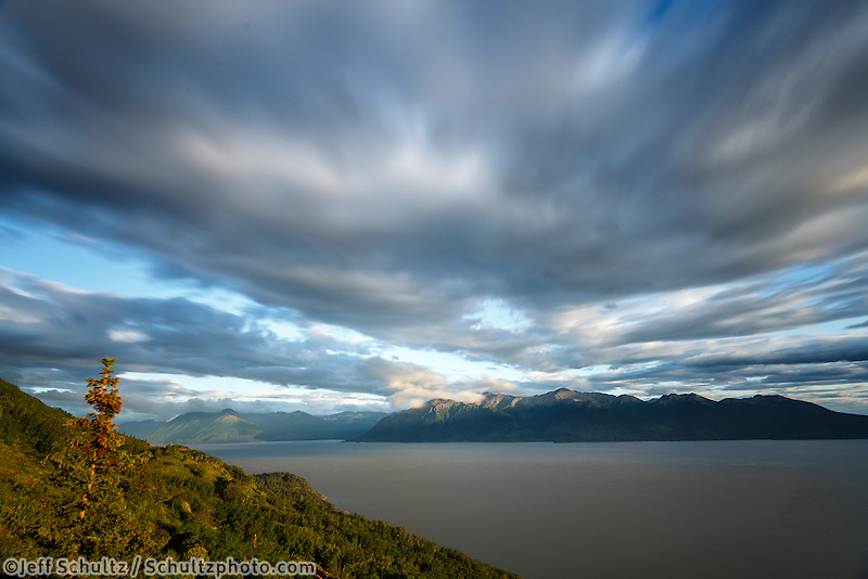 Summer scenic landscape of clouds and tundra hillside of Chugach Mountains overlooking Turnagain Arm and Kenai Mountains from Anchorage, Alaska <br />