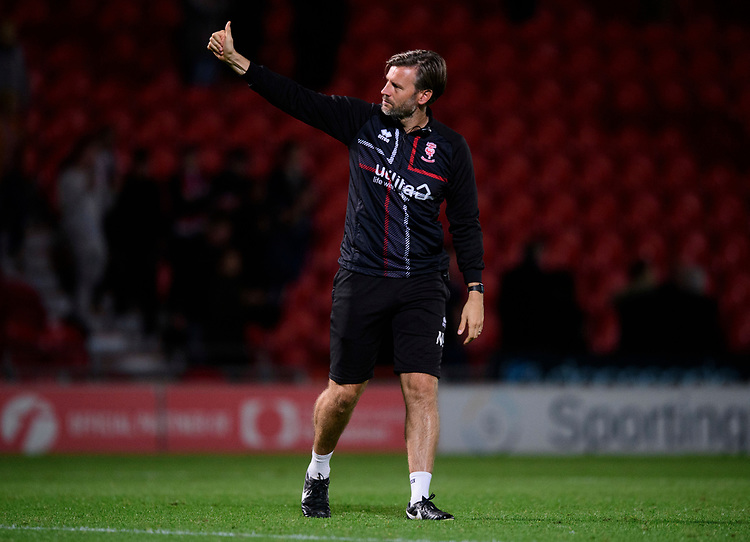 Lincoln City's assistant manager Nicky Cowley acknowledges the fans at the end of the game<br /> <br /> Photographer Chris Vaughan/CameraSport<br /> <br /> EFL Leasing.com Trophy - Northern Section - Group H - Doncaster Rovers v Lincoln City - Tuesday 3rd September 2019 - Keepmoat Stadium - Doncaster<br />  <br /> World Copyright © 2018 CameraSport. All rights reserved. 43 Linden Ave. Countesthorpe. Leicester. England. LE8 5PG - Tel: +44 (0) 116 277 4147 - admin@camerasport.com - www.camerasport.com