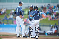 West Michigan Whitecaps pitching coach Jorge Cordova (40) has a meeting on the mound with starting pitcher Matt Manning (16) and catcher Brady Policelli (6) during the game against the South Bend Cubs at Fifth Third Ballpark on June 10, 2018 in Comstock Park, Michigan. The Cubs defeated the Whitecaps 5-4.  (Brian Westerholt/Four Seam Images)
