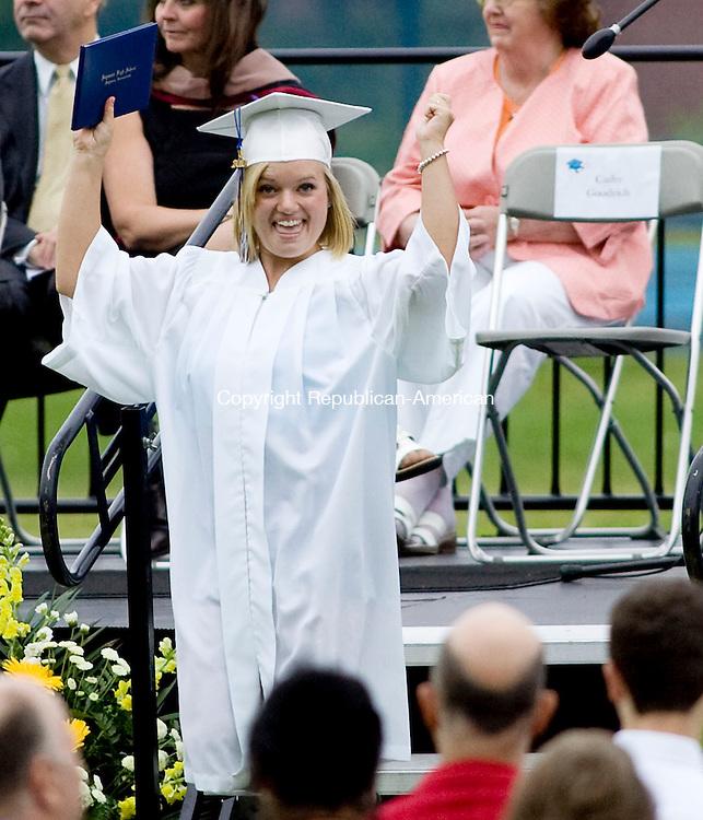 SEYMOUR, CT - 16 JUNE 2010 -061610JT08-<br /> Seymour High School graduate Kristen Barrett celebrates after receiving her diploma during Wednesday's graduation ceremonies at the school.<br /> Josalee Thrift Republican-American