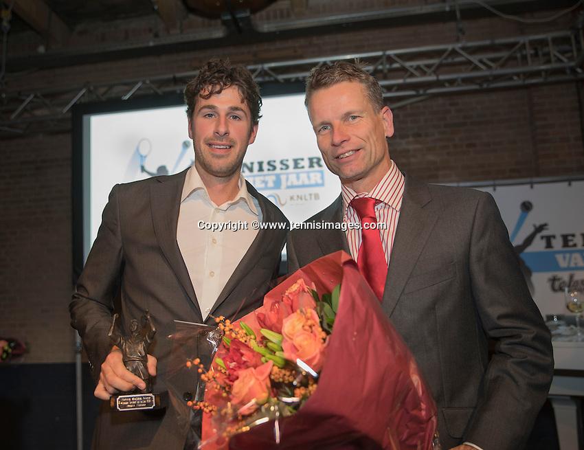 Amsterdam, Netherlands, December 12, 2016, Harbour Club, Tennisser van het Jaar,  Robin Haase receives the Richard Krajicek penning out of the hands of Jan Siemerink<br /> Photo: Tennisimages/Henk Koster