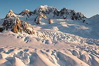 Crevasses and seracs of Explorer Glacier on top of Fox Glacier during setting sun with Mt. Tasman dominating skyline, Westland Tai Poutini National Park, West Coast, UNESCO World Heritage Area, New Zealand, NZ
