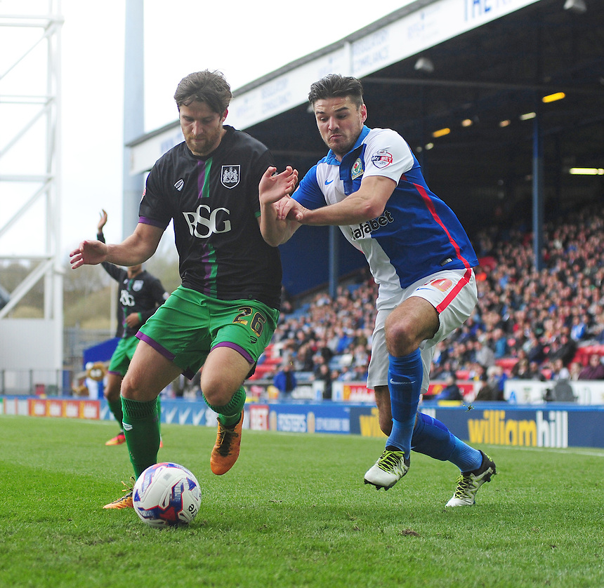 Bristol City&rsquo;s Adam Matthews shields the ball from Blackburn Rovers' Ben Marshall<br /> <br /> Photographer Chris Vaughan/CameraSport<br /> <br /> Football - The Football League Sky Bet Championship - Blackburn Rovers v Bristol City - Saturday 23rd April 2016 - Ewood Park - Blackburn <br /> <br /> &copy; CameraSport - 43 Linden Ave. Countesthorpe. Leicester. England. LE8 5PG - Tel: +44 (0) 116 277 4147 - admin@camerasport.com - www.camerasport.com