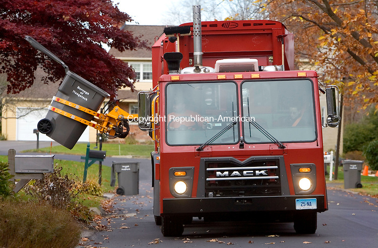 NAUGATUCK, CT. 10 November 2010-111010SV01--Trash crews pick up the trash with the department&rsquo;s new automated trash truck in Naugatuck Wednesday. <br /> Steven Valenti Republican-American