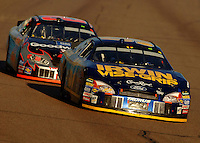 Nov 13, 2005; Phoenix, Ariz, USA;  Nascar Nextel Cup driver Kenny Wallace subbing for the suspended Kurt Busch, drives the #97 Irwin Ford leads Kevin Harvick during the Checker Auto Parts 500 at Phoenix International Raceway. Mandatory Credit: Photo By Mark J. Rebilas