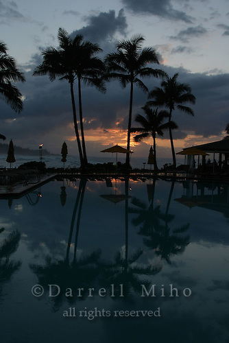 Feb. 17, 2006; Kahuku, Oahu, HI - Palm trees reflect in the pool at sunset at the Turtle Bay Resort on the north shore of Oahu...Photo Credit: Darrell Miho.© Darrell Miho