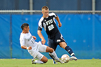 10 September 2011:  FIU's Quentin Albrecht (22) battles Stetson's Jonathan Mendoza (11) for the ball in the first half as the FIU Golden Panthers defeated the Stetson University Hatters, 3-2 in the second overtime period, at University Park Stadium in Miami, Florida.