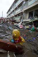 A winnie the pooh lies amongst the wreckage in Natori, near Sendai, Japan.  Personal belongs were the greatest loss with people returning looking for momentos of loved ones lost photo albums, pictures and family heirlooms. .16 Mar 2011.