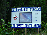 Sign warning women against hitchiking on Highway of Tears, HWY 16