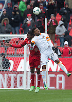 20 April 2013:Toronto FC defender Gale Agbossoumonde #6 and Houston Dynamo midfielder Giles Barnes #23 in action during the first half in an MLS game between the Houston Dynamo and Toronto FC at BMO Field in Toronto, Ontario Canada...