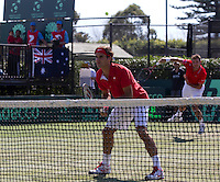 ROGER FEDERER (SUI) and STANLINAS WAWRINKA (SUI) against LLEYTON HEWITT (AUS) and CHRIS GUCCIONE (AUS) in the third rubber. Lleyton Hewitt and Chris Guccione beat Roger Federer and Stanlinas Wawrinka 2-6 6-4 6-2 7-6...Tennis - Davis Cup - World Group - Royal Sydney Golf Club - Sydney - Day 1 - Saturday September 17th 2011..© AMN Images, Barry House, 20-22 Worple Road, London, SW19 4DH, UK..+44 208 947 0100.www.amnimages.photoshelter.com.www.advantagemedianetwork.com.