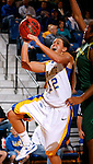 BROOKINGS, SD - NOVEMBER 23rd, 2008 : Alison Anderson, a junior guard for South Dakota State nails her lay up over the hands of Lindsey Saffold of Oregon during their game Sunday afternoon at Frost Arena on the campus of South Dakota State University in Brookings, SD. (Photo By Ty Carlson/Inertia)