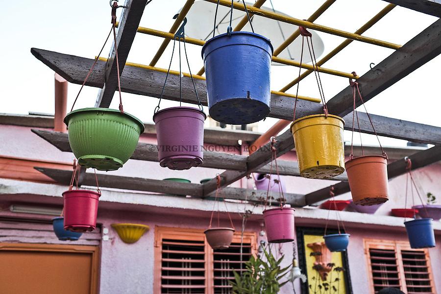 GAZA, Zaytoun: Flower pots colored by Mohammed Al Saedy in pastel colors. 15/08/15<br /> <br /> GAZA , Zaytoun :Des pots de fleurs color&eacute;s par Mohammed Al Saedy en couleurs pastelles. 15/08/15