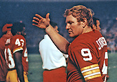 Washington Redskins quarterback Sonny Jurgensen (9) discusses strategy on the sidelines during a preseason game against the Baltimore Colts at RFK Stadium in Washington, D.C. on August 25, 1973.  The Redskins won the game 20 - 3..Credit: Arnie Sachs / CNP