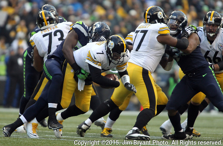 Pittsburgh Steelers quarterback Ben Roethlisberger (7) is sacked by Seattle Seahawks defensive end Michael Bennett (72) at CenturyLink Field in Seattle, Washington on November 29, 2015.  The Seahawks beat the Steelers 39-30.      ©2015. Jim Bryant Photo. All Rights Reserved.