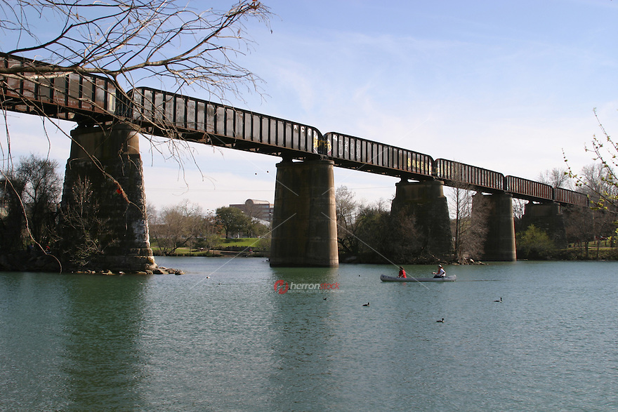 Austinites enjoy canoeing and kyaking under the Union Pacific Railroad Bridge on Lady Bird Lake in Austin, Texas.
