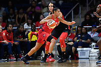 Washington, DC - July 13, 2019: Washington Mystics guard Natasha Cloud (9) drives past Las Vegas Aces center Liz Cambage (8) on her way to the basket during 1st half action of game between Las Vegas Aces and Washington Mystics at the Entertainment & Sports Arena in Washington, DC. (Photo by Phil Peters/Media Images International)