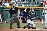 Bobby Wilson (18) of the Reno Aces behind the plate with home plate umpire Nick Mahrley in action against the Salt Lake Bees at Smith's Ballpark on May 4, 2014 in Salt Lake City, Utah.  (Stephen Smith/Four Seam Images)