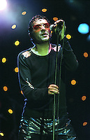 Rachid Taha.<br /> Algerian singer based in France. His music is influenced by many different styles such as rock, electronic, punk and ra&iuml;.<br /> WOMAD Festival, Reading, England, July 2002.