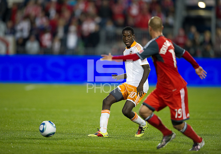 07 May2011: Houston Dynamo midfielder Je-Vaughan Watson #10 looks to get the ball past Toronto FC defender Mikael Yourassowsky #19 during an MLS game between the Houston Dynamo and the Toronto FC at BMO Field in Toronto, Ontario..Toronto FC won 2-1.