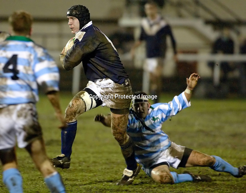 Cambridge University / Oxford University..Pcubed 23rd Rugby League Varsity match..The Athletic Ground, Richmond, March 5, 2003..Pic : Max Flego..James Woolrich powers forward for Oxford