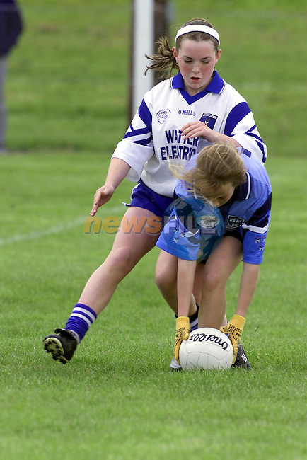 Dublins no 12 Grace O'Neill being tackled by Monaghans No 9 Niamh Kerr during the Dublin V Monaghan All Ireland U/14 Semi Final in Drumbarragh, Co Meath..Picture Fran Caffrey Newsfile.