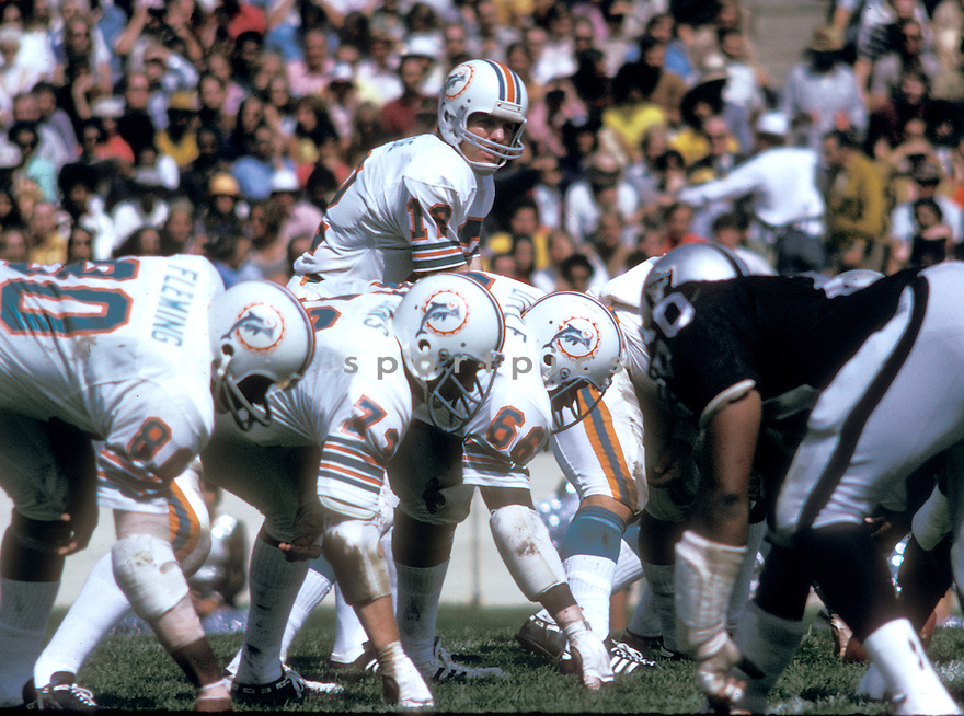 Miami Dolphins Bob Griese (12), in action during a game against the Oakland Raiders on September 23, 1973 at California Memorial Stadium. The Raiders beat the Dolphins 12-7. Bob Griese was inducted to the Pro Football Hall of Fame in 1990