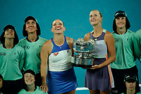 31st January 2020; Melbourne Park, Melbourne, Victoria, Australia; Australian Open Tennis, Day 12; Timea Babos of Hungary  and Kristina Mladenovic of France celebrate with the winners Trophy after beating Hsieh and Strycova in 2 sets to take the Womens Doubles title at the Australian Open