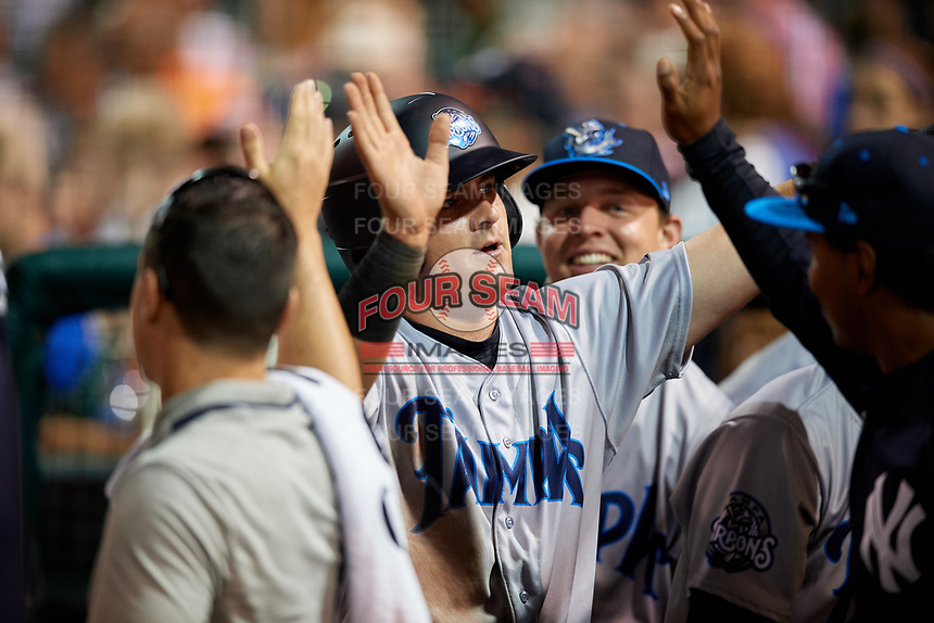 Tampa Tarpons designated hitter Tim Lynch (26) high fives with teammates in the dugout during a game against the Lakeland Flying Tigers on April 5, 2018 at Publix Field at Joker Marchant Stadium in Lakeland, Florida.  Tampa defeated Lakeland 4-2.  (Mike Janes/Four Seam Images)