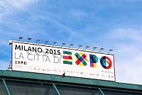 Milano, piazzale Cadorna. Cartellone reclamizzante l'Esposizione Mondiale Expo 2015 --- Milan, Cadorna square. Placard of the World Exhibition Expo 2015